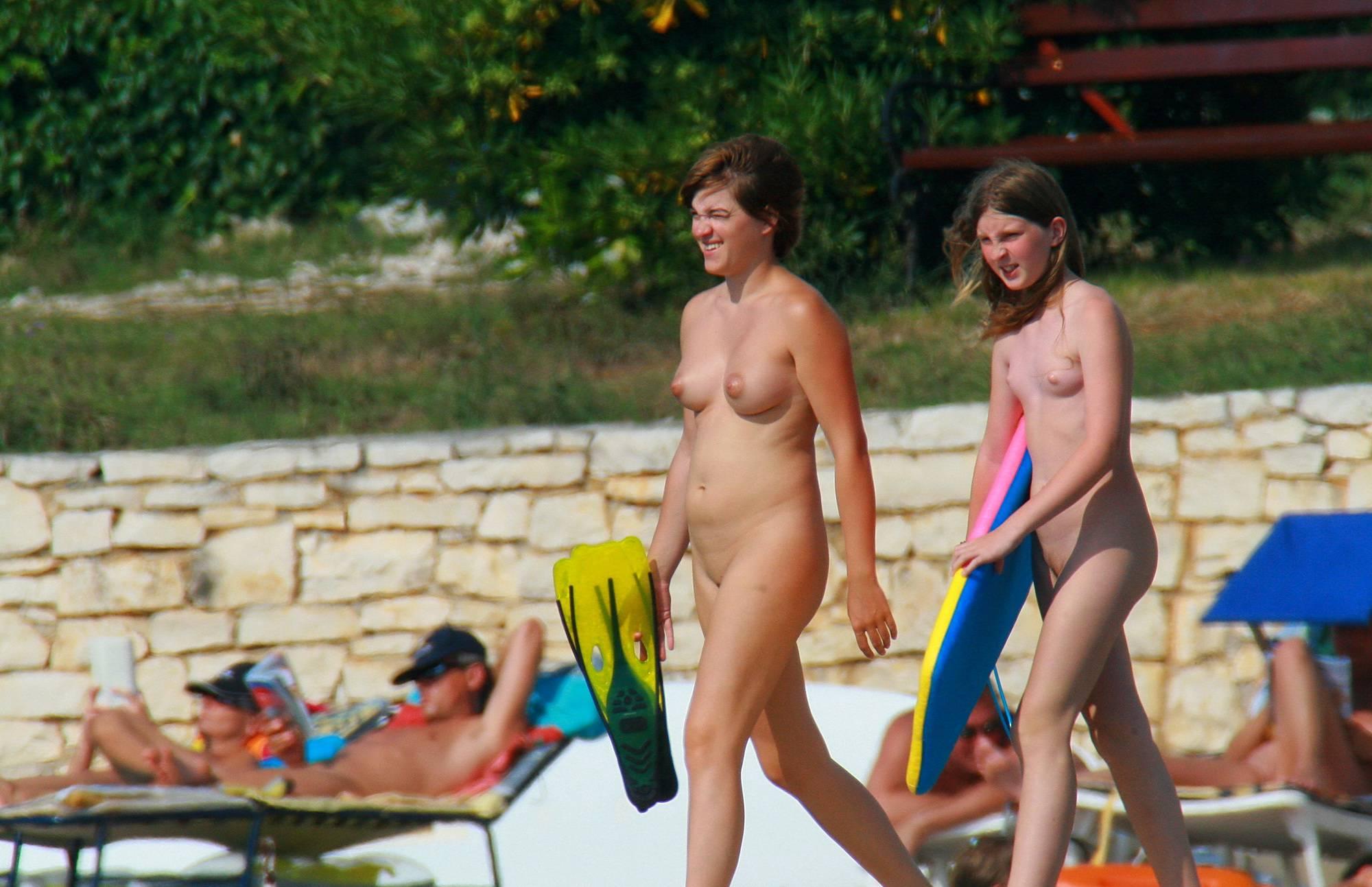 Nudist Gallery Kickboards For A Nice Dip - 1