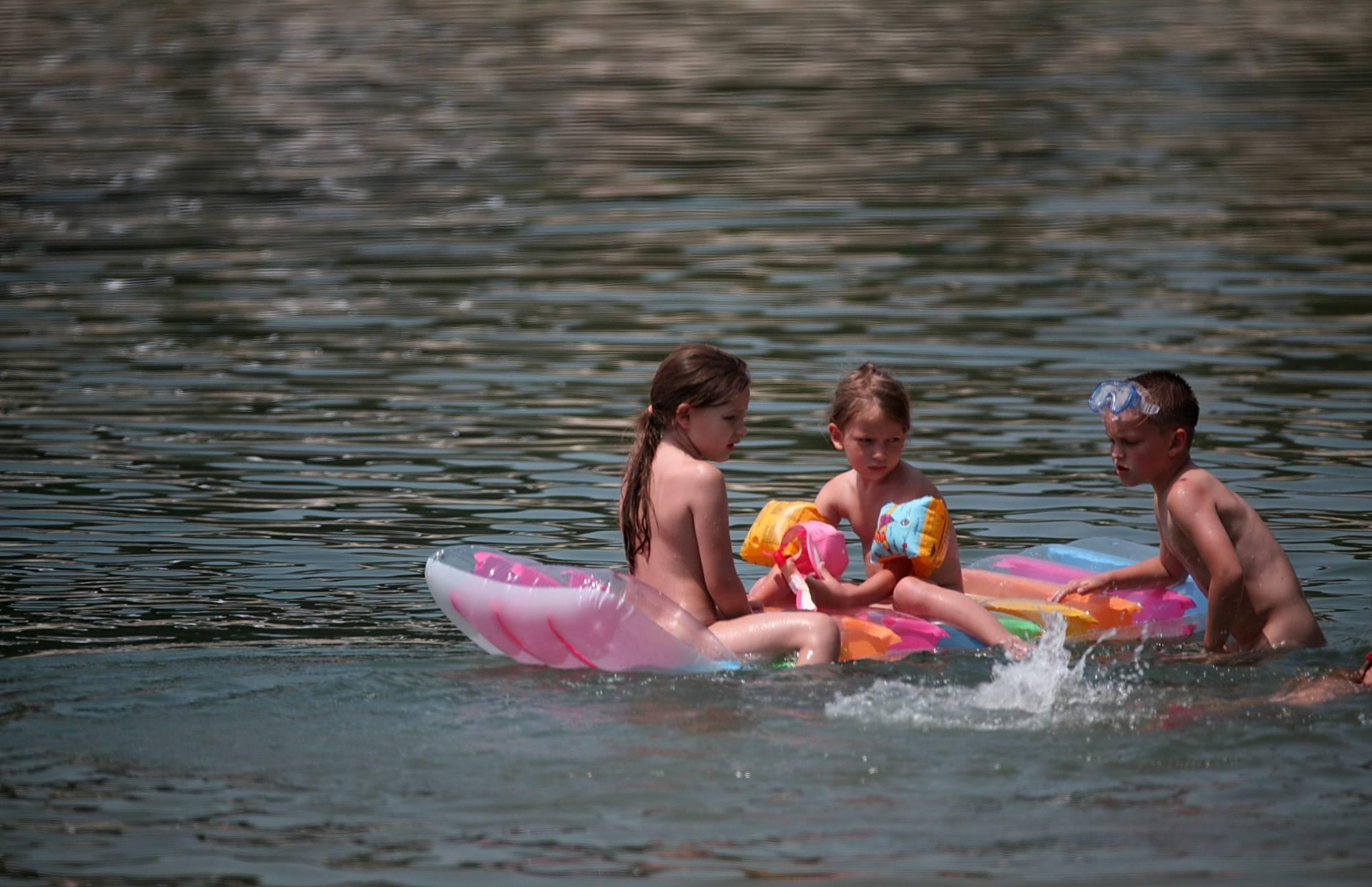 Nudist Pics Relax Aboard A Floaty Raft - 1