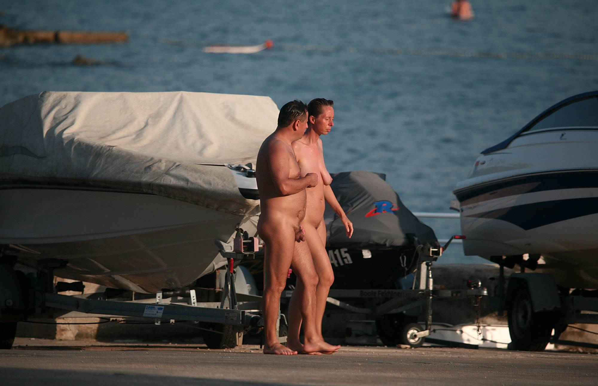 Nudist Gallery Walk by the Boats and Car - 2
